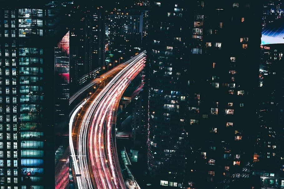 city-traffic-night-lights-building-skyscraper