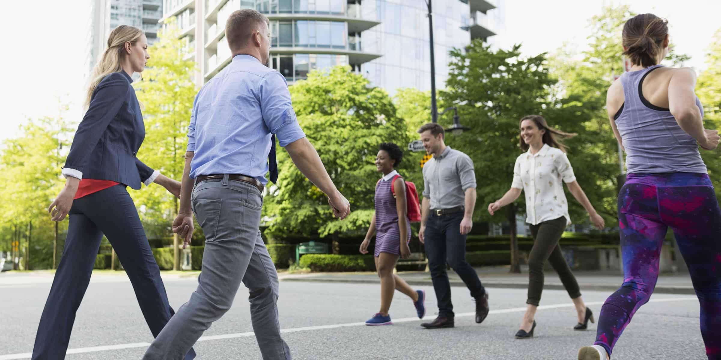 pedestrians-walk-street-stock-today-main-180911